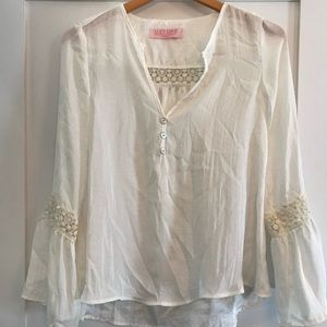 White flowy peasant top with lace detail